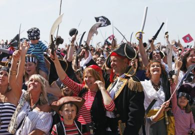 Crowd of people dressed as pirates