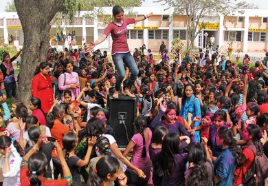 A crowd of students at a campus in India