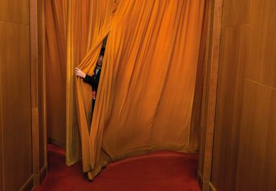 Person hiding behind curtain