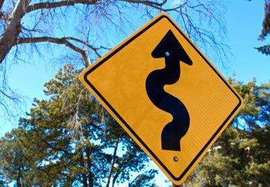 Curvy road ahead sign
