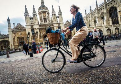 Cyclist outside University of Cambridge