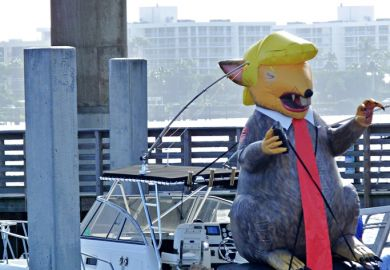 December 29, 2018, Lake Worth, Florida, USA. An inflatable balloon resembling President Trump is located on a boat who opposes the President.
