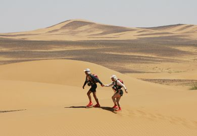 Two people in desert
