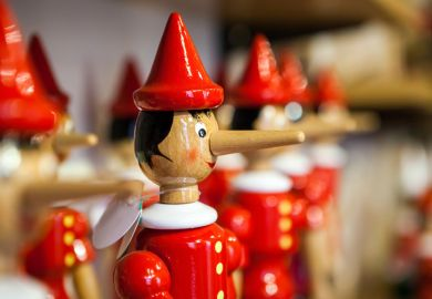 Display of Pinocchio puppets on shop shelf