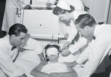 doctors administering electroshock therapy