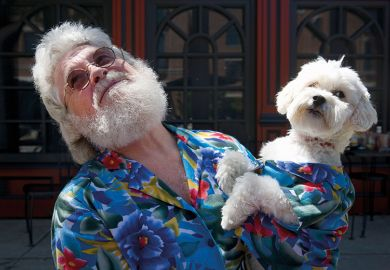 Man and dog dressed alike