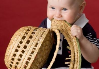 Toddler eating his hat
