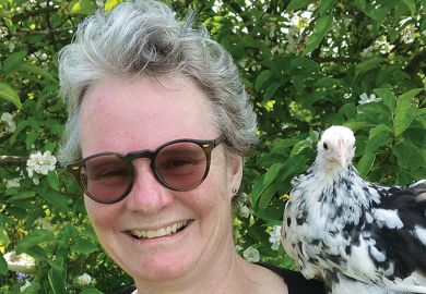 Author Emma Gee with a chicken on her shoulder