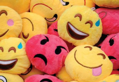 Pile of soft toy emoji faces
