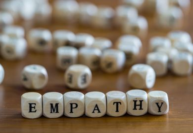 """Dice spell out the word """"empathy"""""""