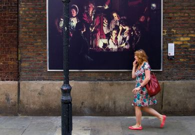 A reproduction of 'An Experiment on a Bird in the Air Pump' by Joseph Wright of Derby is displayed in Soho in central London, 2007