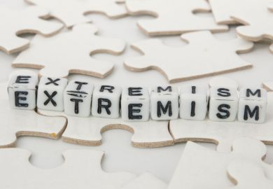 'Extremism' spelled out in letter blocks on jigsaw