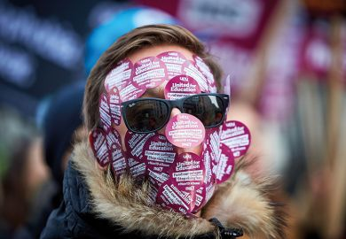 Face covered with UCU stickers