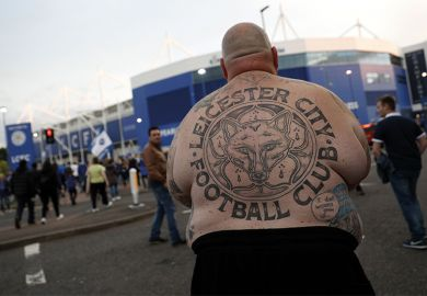 Shirtless football fan with Leicester City back tattoo