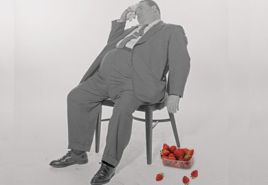 Fat man with punnet of strawberries