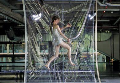 Female model vacuum-sealed during Paris Fashion Week