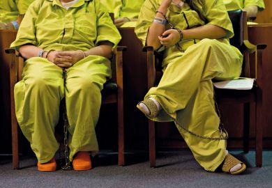 Female prisoners sitting in court room