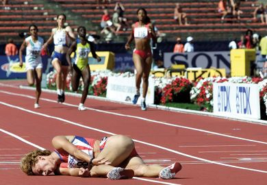 female runner lays on the floor