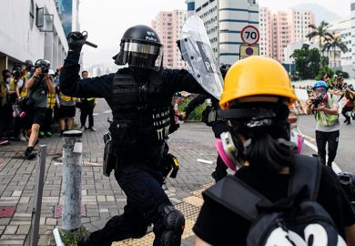 Police clash with protesters in Kowloon Bay, Hong Kong in August 2019