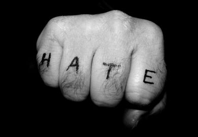 Fist with hate tattoo