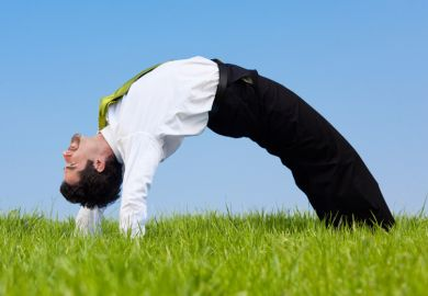 Flexible businessman bending over backwards