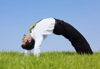 A flexible businessman bends over backwards