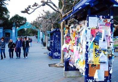 Flyers hang on a kiosk in Sproul Plaza, outside the gates of the University of California, Berkeley