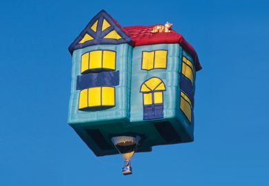 Flying hot air balloon shaped like house