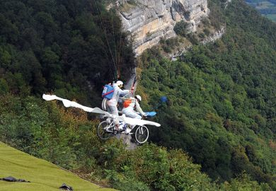 "Paragliders compete on their ""tandem bicycle"" in Saint-Hilaire du Touvet, France, 2012, illustrating entrepreneurship"