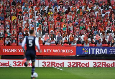 Soccer player in front of carcboard cutout crowd. Shows diverse supporters to relate to subject diversity improving globally.