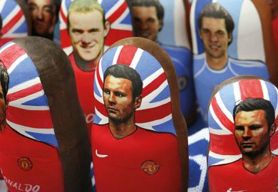 "Portraits of Manchester United footballers Wayne Rooney, Cristiano Ronaldo and Ryan Giggs on traditional Russian ""matreshka"" nesting dolls in Moscow"