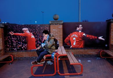 football fan sitting alone