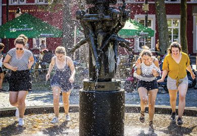 Women cool off in a fountain in Maastricht, on August 8, 2020