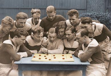 men planning football strategy