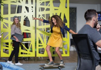 Woman skateboarding in office