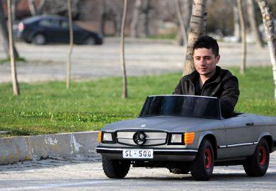 Man driving small car