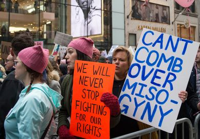 Participants at the Women's March in New York City on January 21, 2017. The placard at centre refers to US President Donald Trump and reads: 'Can't comb over misogyny'