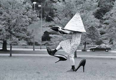Woman in giant shoes and hat