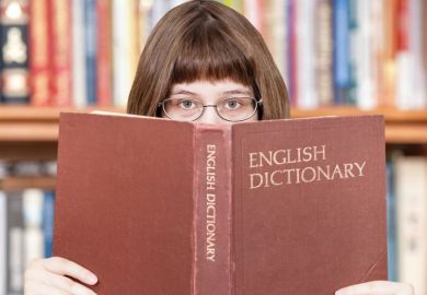 Girl looking over dictionary