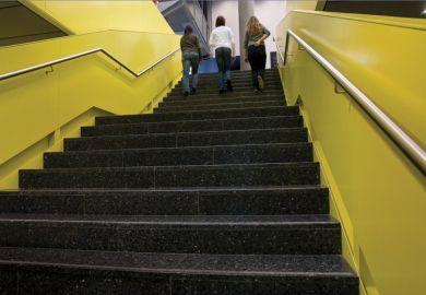 Girls climb stairs