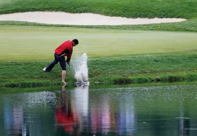Golfer in water