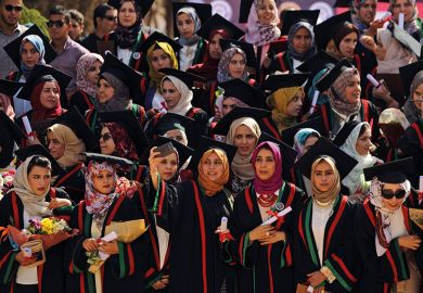 Libyan pharmacy students pose for a selfie during their graduation ceremony at the Al-Arab University in Benghazi, 2016