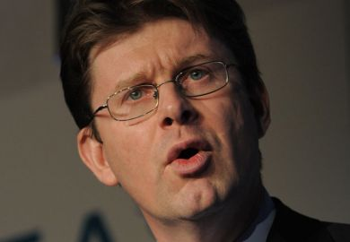 Greg Clark speaking at conference