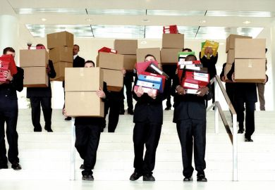 Group of businessmen carrying boxes from office