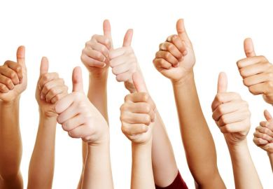 Group of hands with thumbs-up