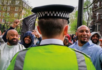 Group of muslim men and British police officer