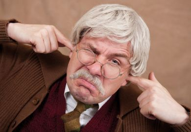 Grumpy man with fingers in ears
