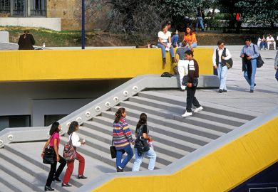 Students walking up stairs on campus