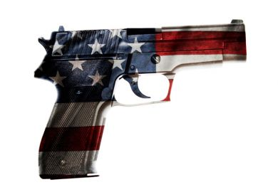A gun with the colours of the US flag
