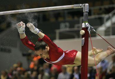 Gymnast falling off bars